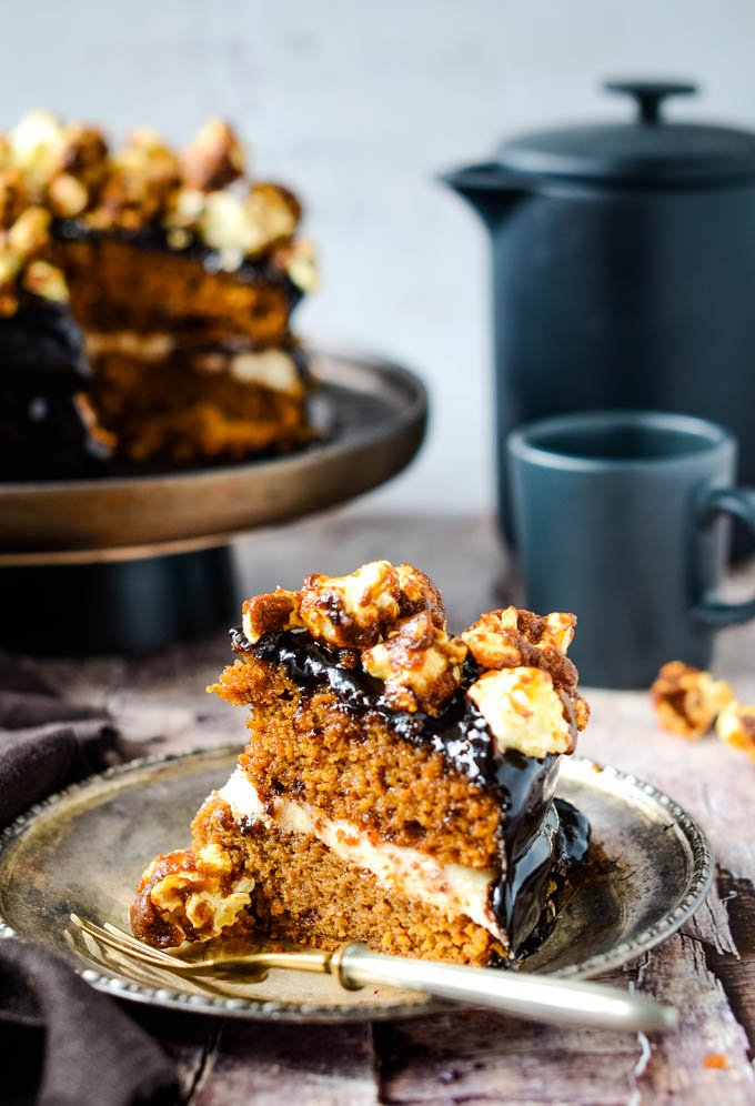 cake with coffee pot behind