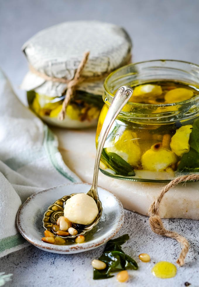mozzarella marinated in olive oil with pine nuts and basil