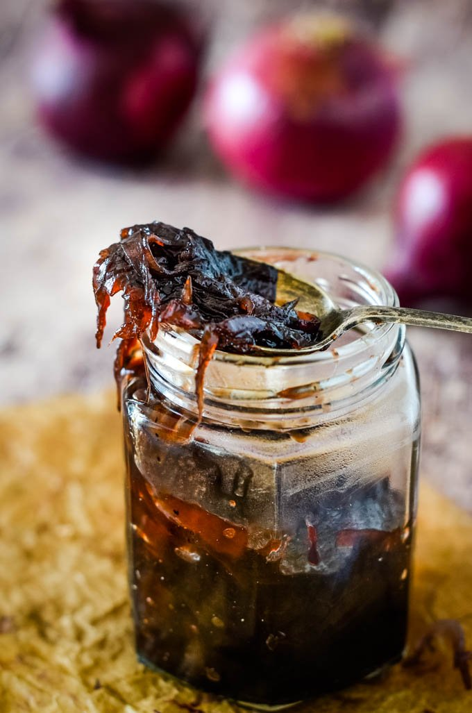 red onion marmalade on spoon on top of jar