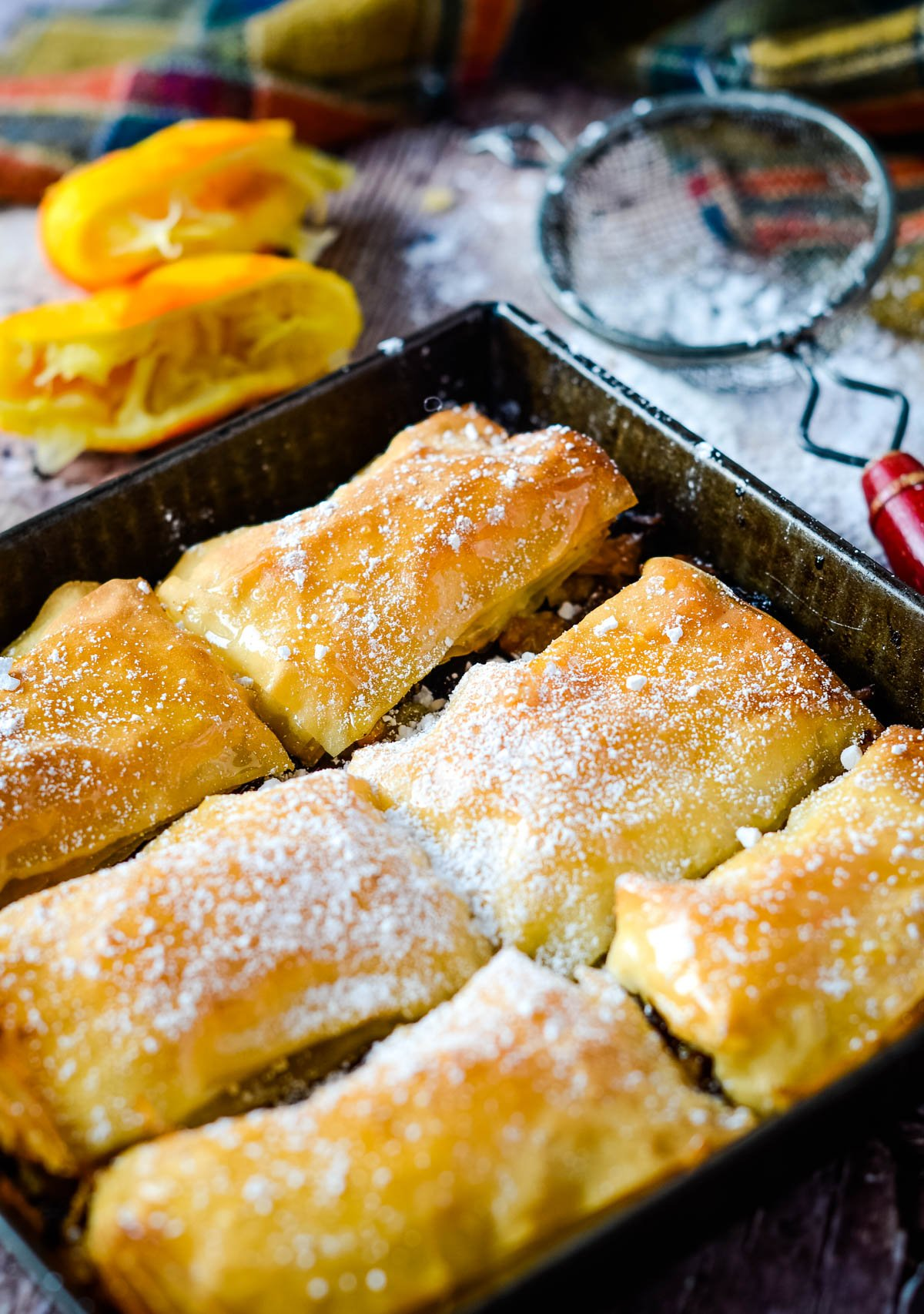 icing sugar sifted over baklava in tin