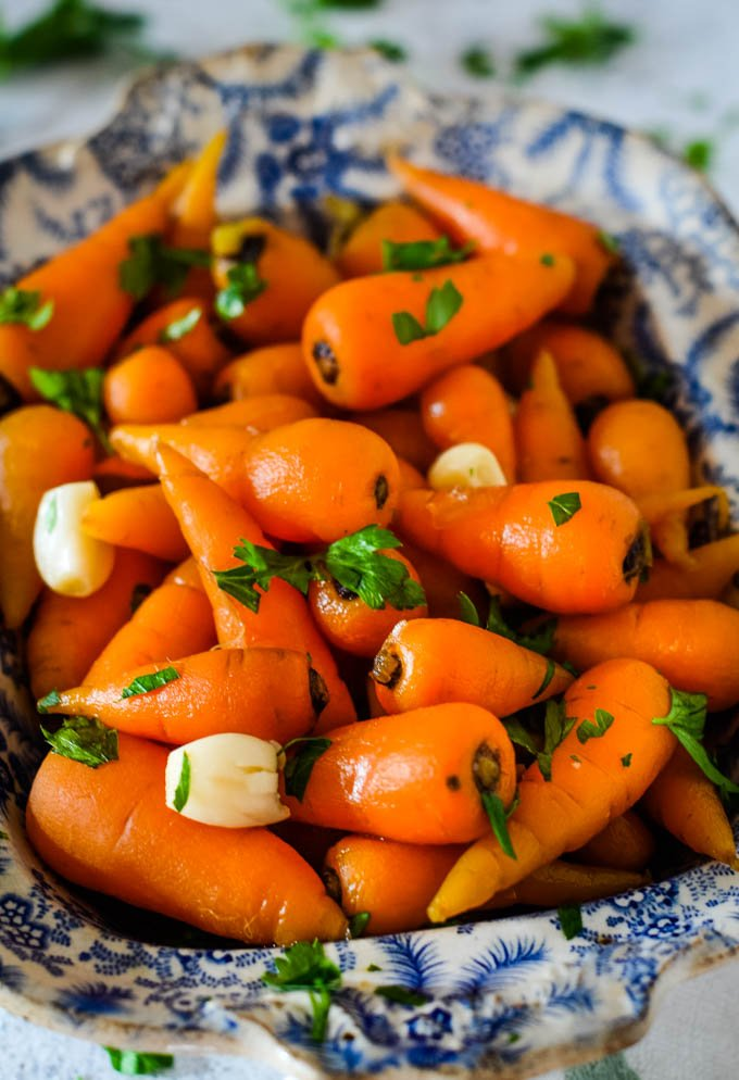 close up of carrots in serving dish
