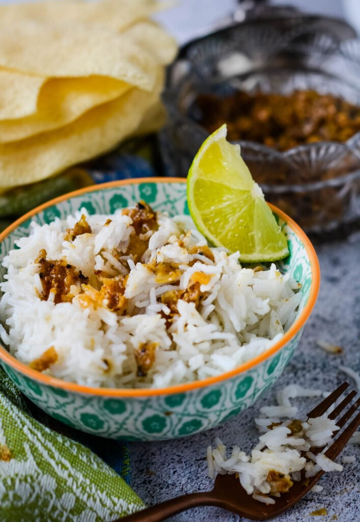 lime pickle stirred into bowl of rice