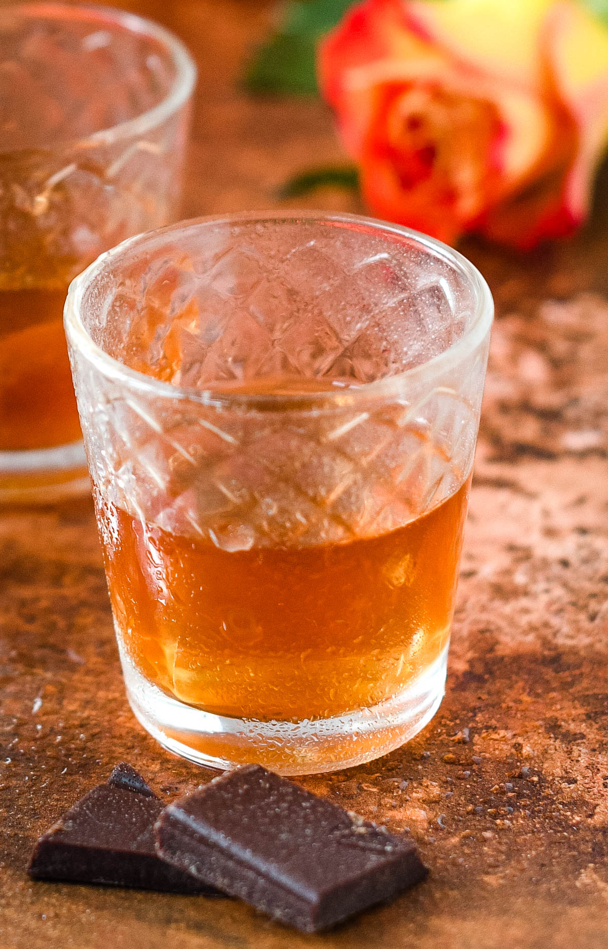 close up of shot glass with liqueur and ice