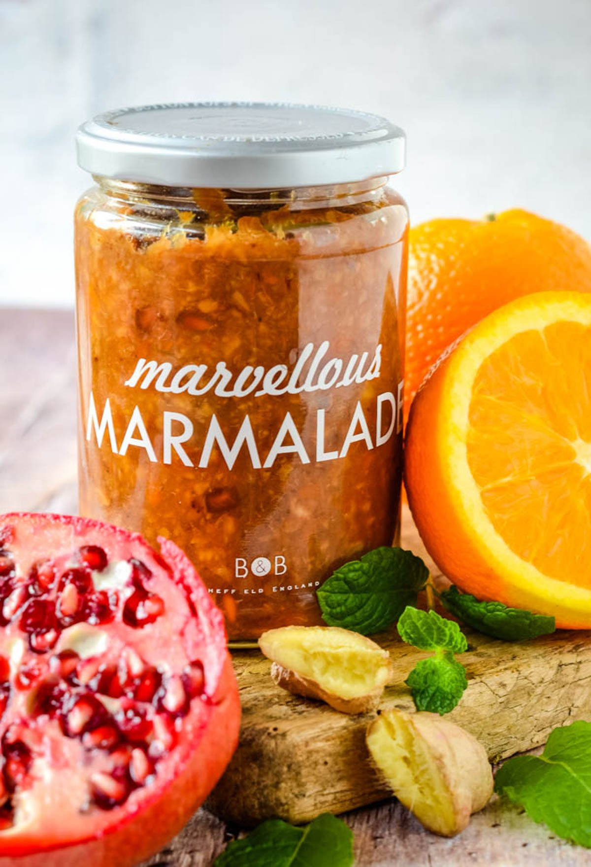 jat of marmalade with ingredients beside it