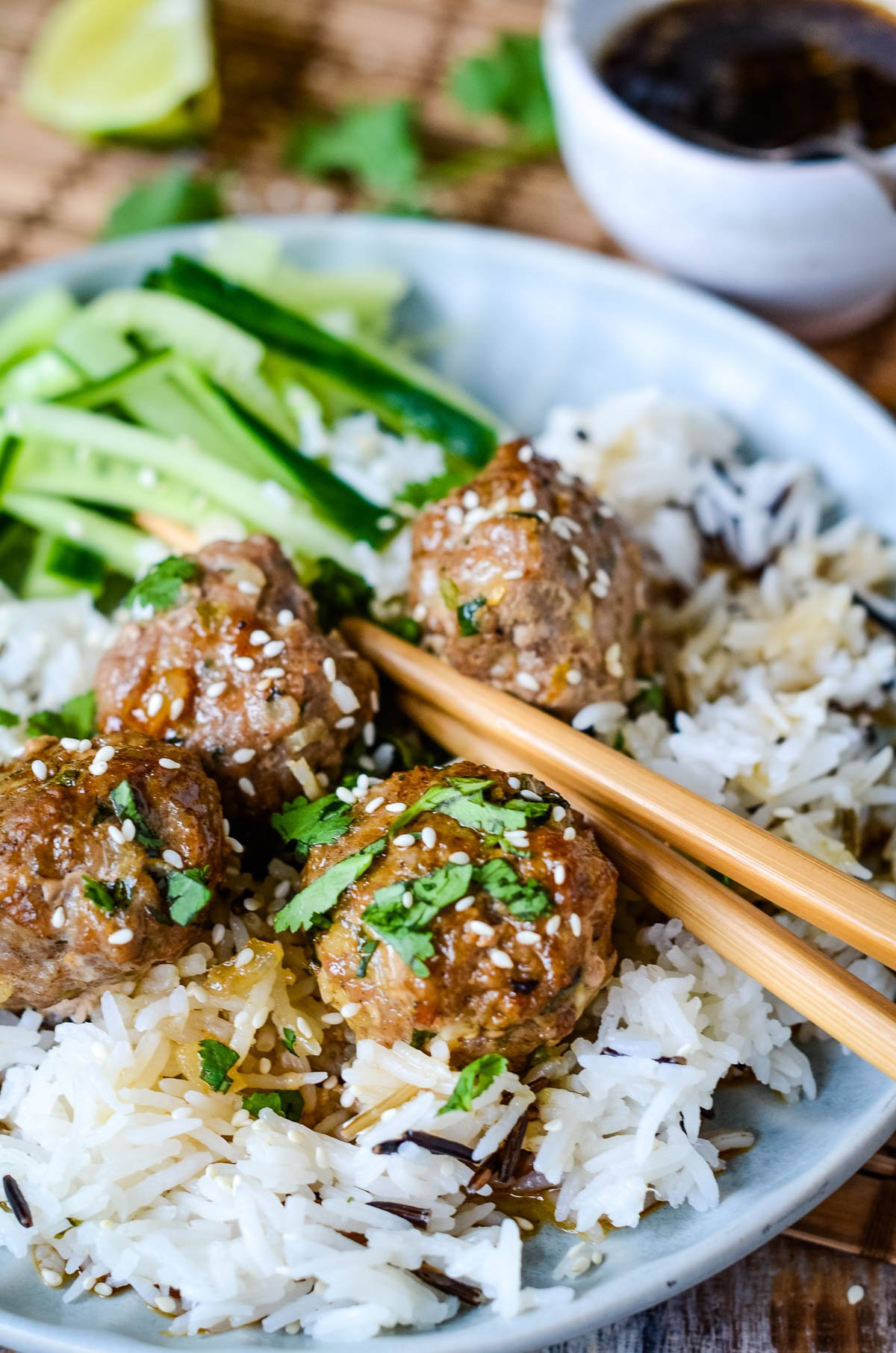 sweet and sour pork meatballs with rice and chopsticks