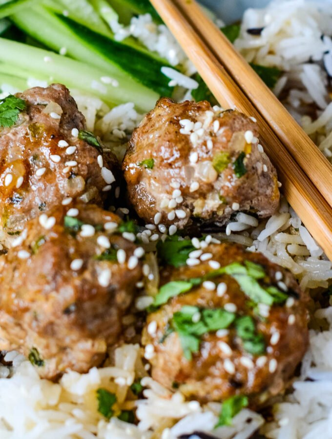 sweet and sour pork meatballs with marmalade glaze with chopsticks in bowl