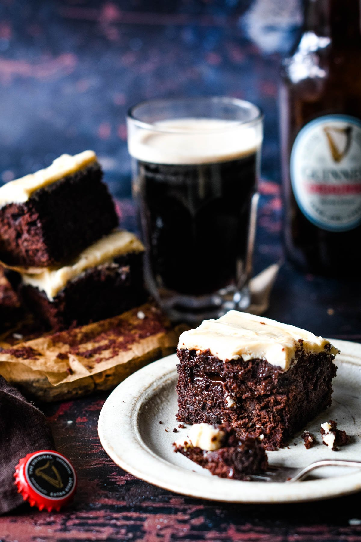 plate of brownies with beer in background