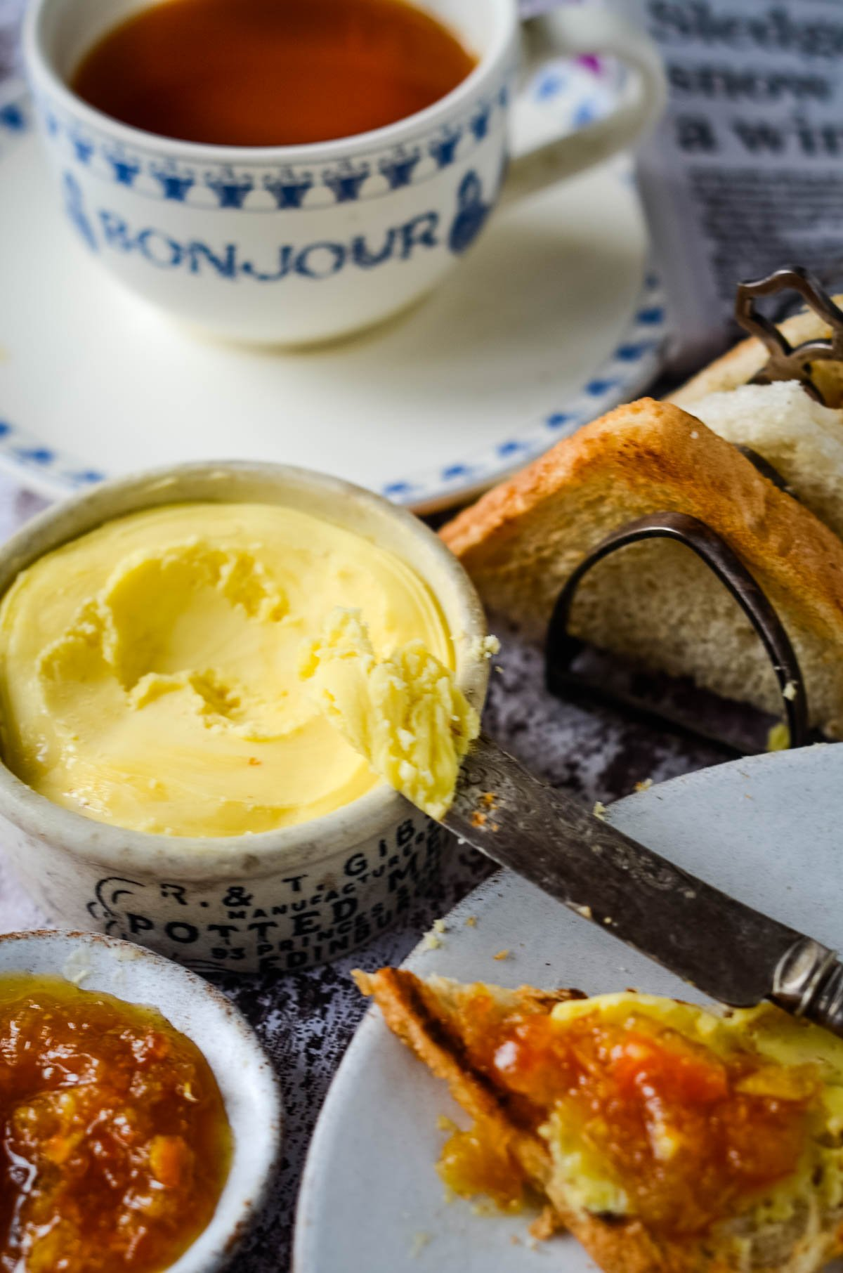 scooping butter out of small bowl with knife