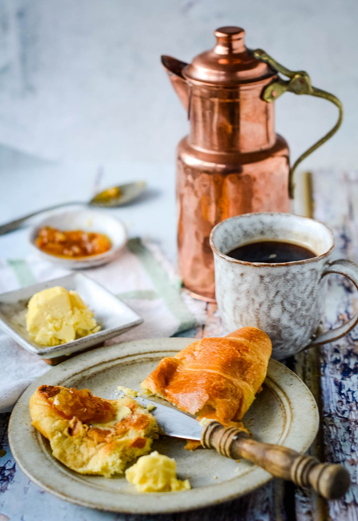 butter with coffee pot and croissants
