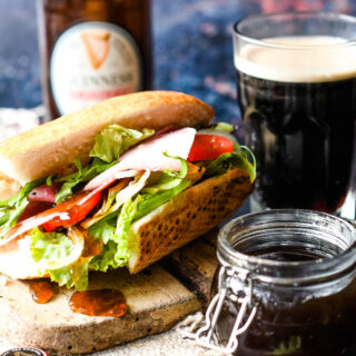 spiced Guinness jelly on sandwich with Guinness behind