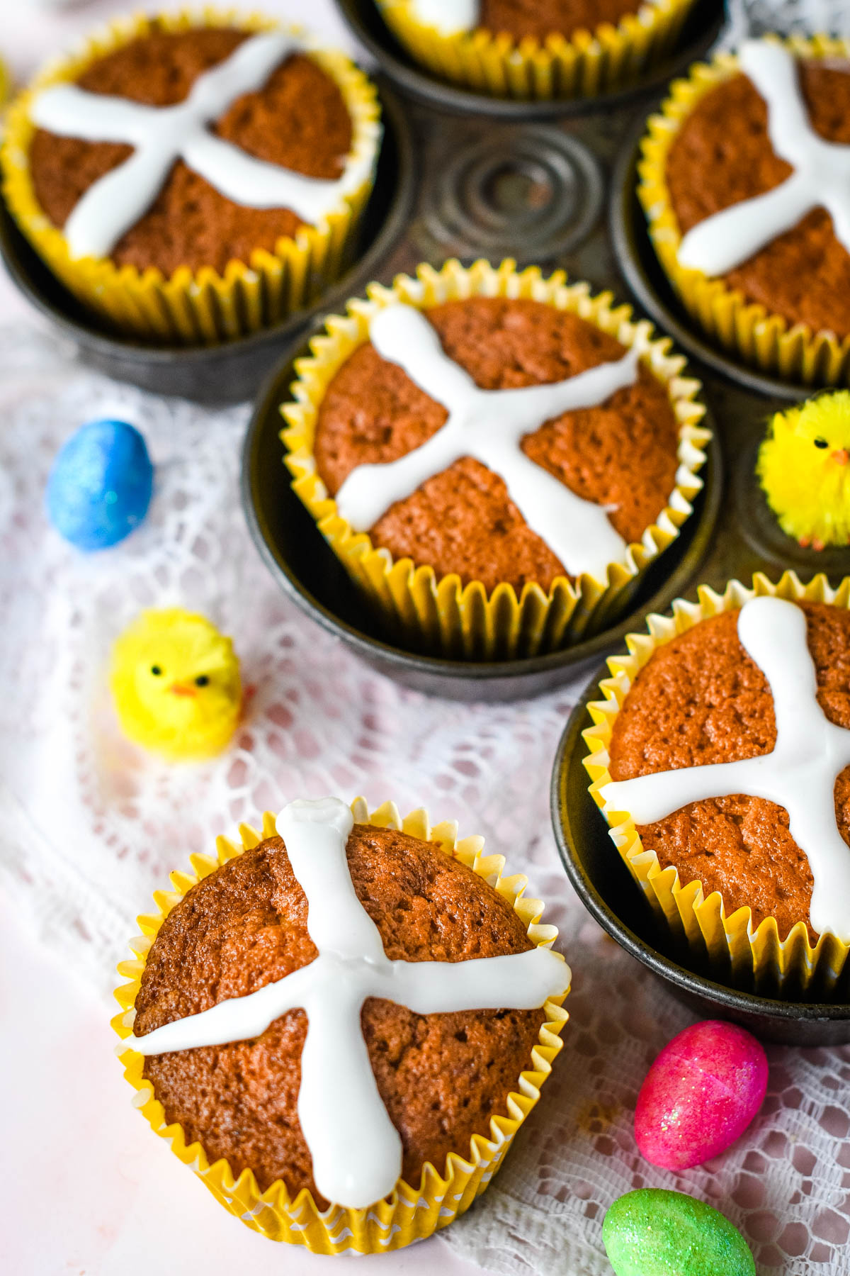 hot cross bun cupcakes in baking tray