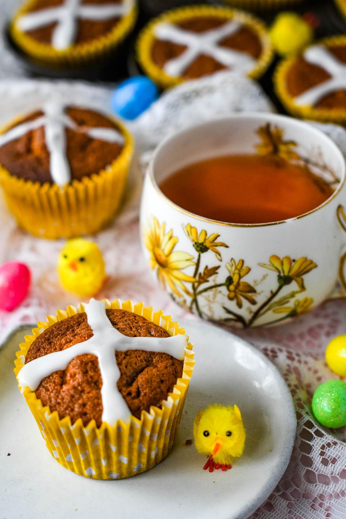hot cross bun cupcakes with cup of tea