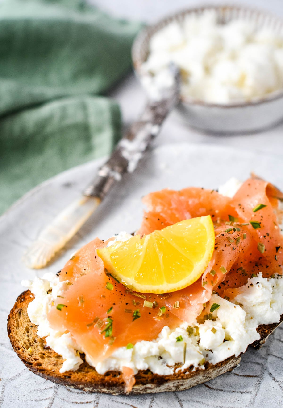 homemade ricotta cheese on toast with smoked salmon
