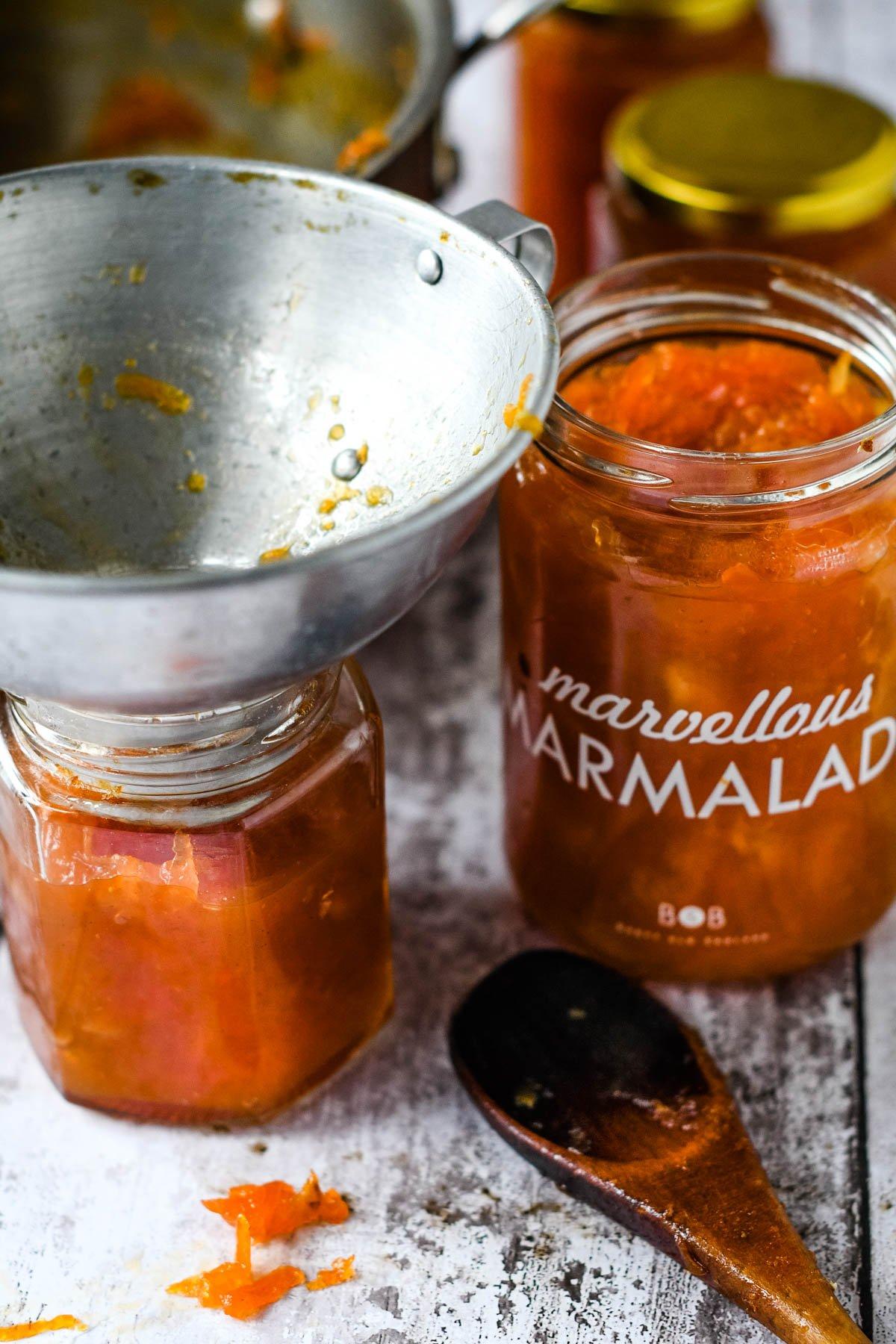 pouring marmalade into sterilised jars