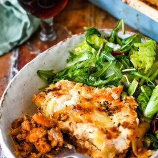 vegetarian lasagne on plate with salad