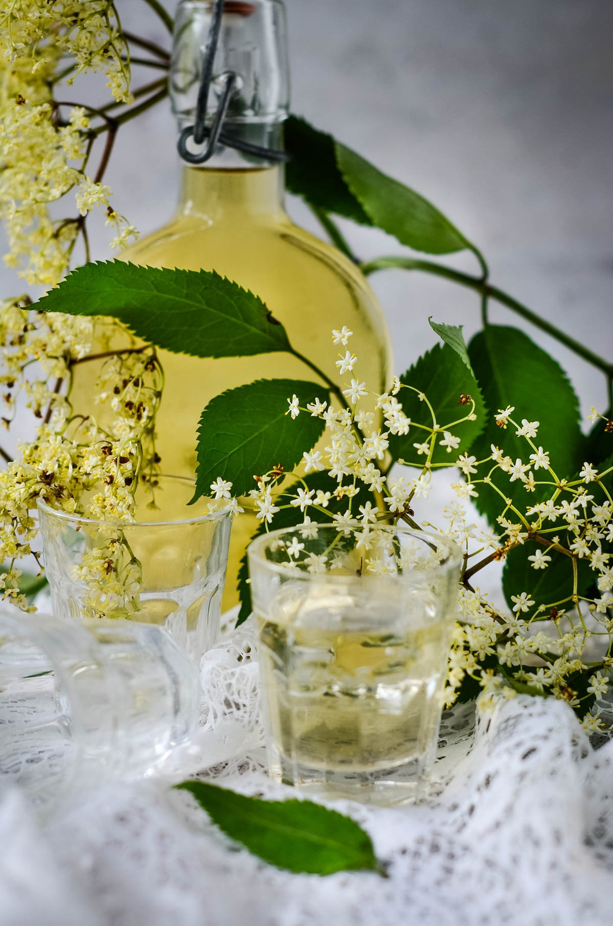 elderflower liqueur with bottle in background