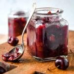 cherry chutney in jar with spoon