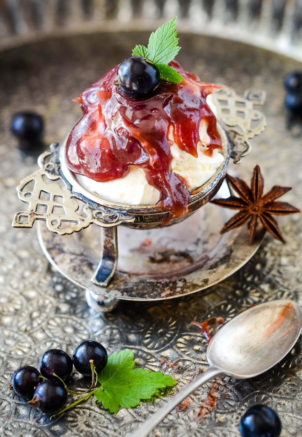 curd as dessert topping on ice cream on silver tray with spoon at side