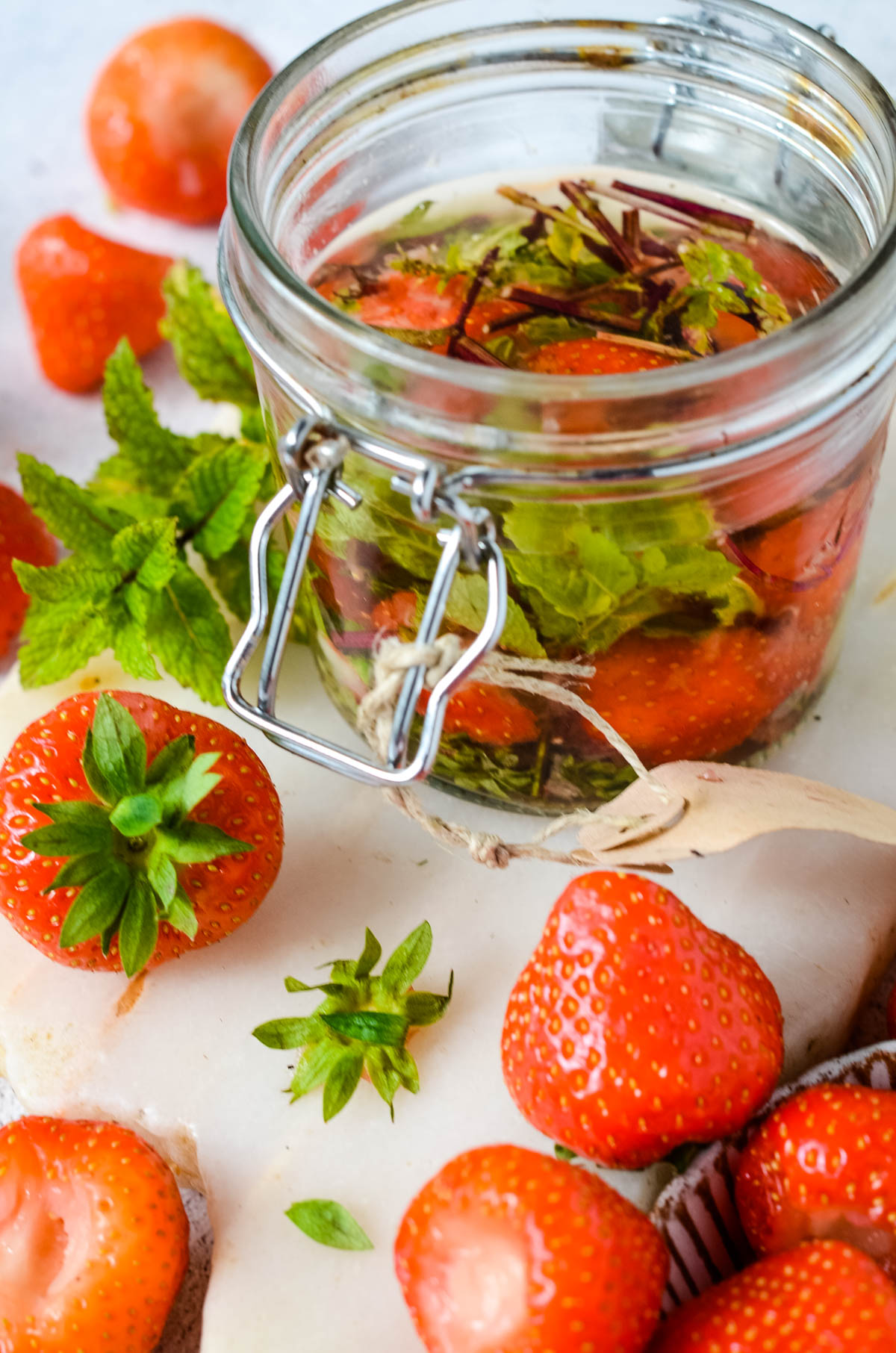 steeping the strawberries and mint in jar with the vinegar