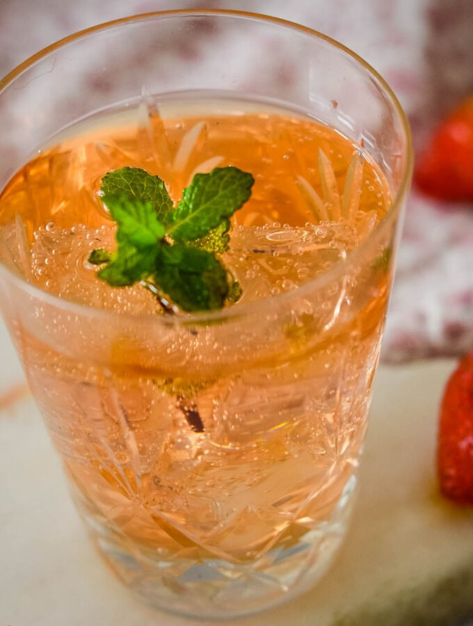 strawberry and mont shrub with mint in glass