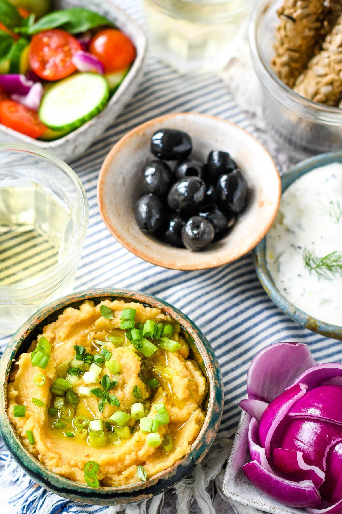 mezze of fava, tzatziki, olives and salad