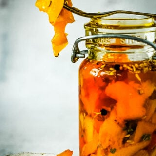 spiced paprika peppers in jar with fork on top