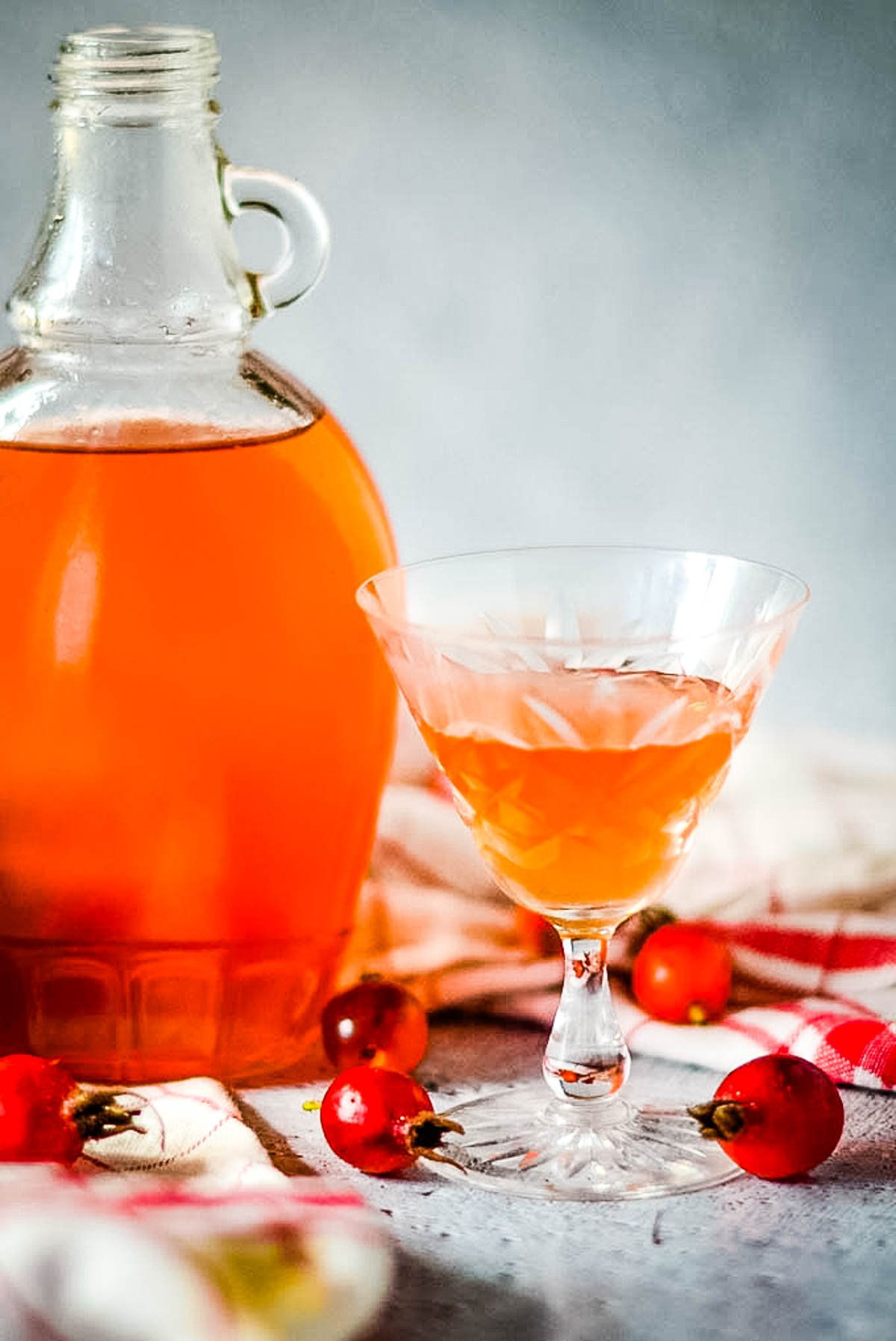 bottle of syrup with glass in front