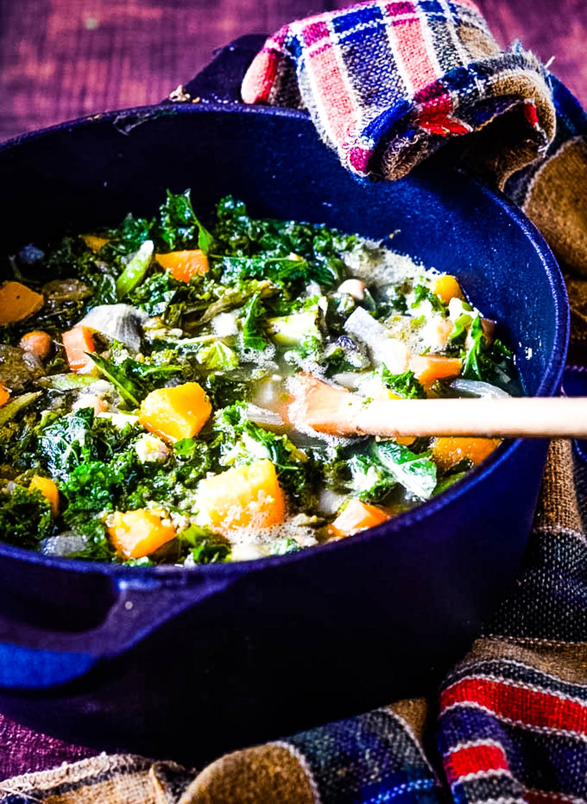 squash kale and chickpea soup in pan