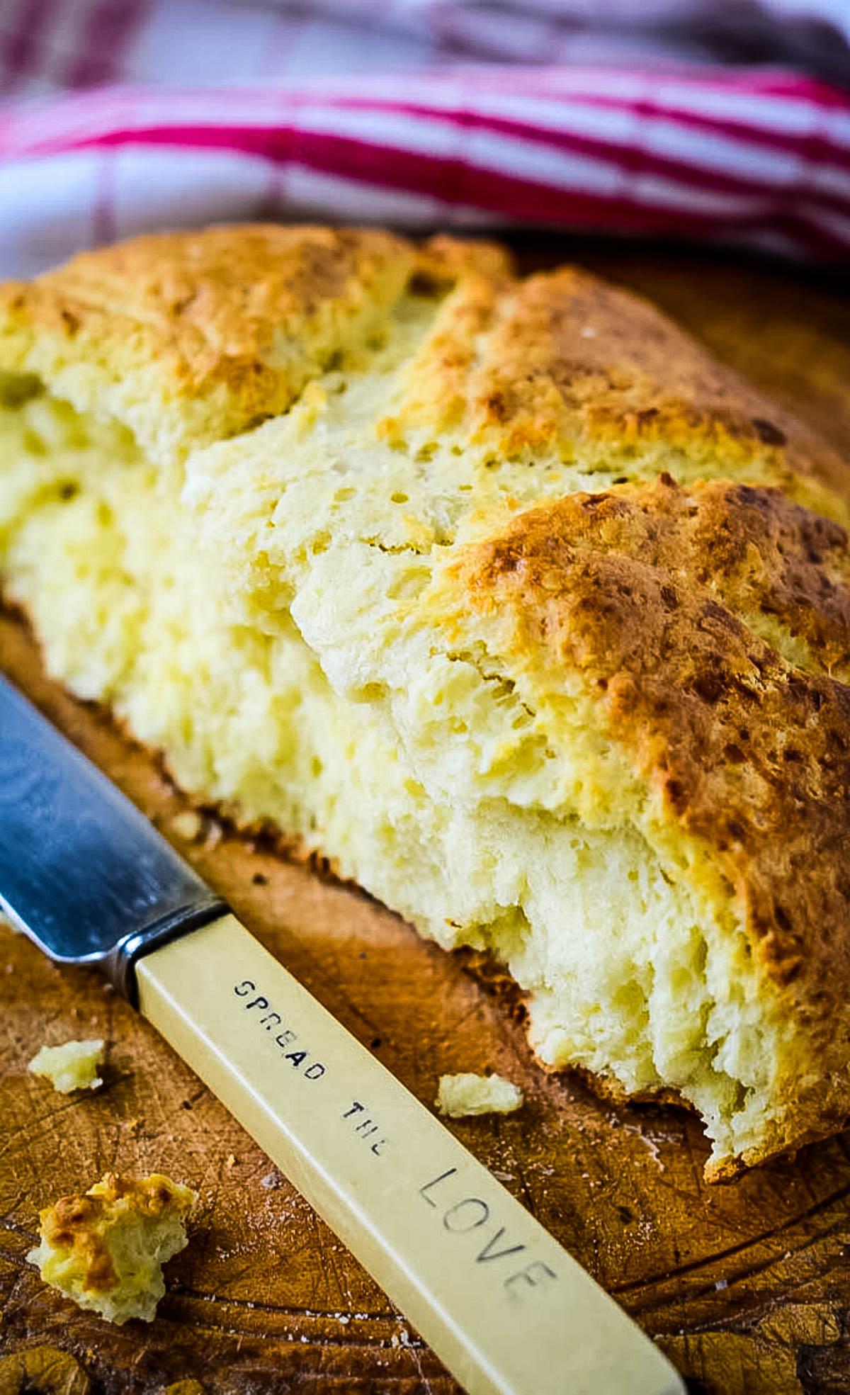 knife beside half loaf of bread